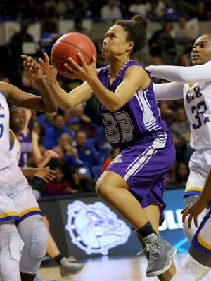 Fayetteville's Lauren Holmes was a part of ÿve team championships for the Lady Bulldogs, but will concentrate on just one — basketball — when she enrolls at North Texas this fall.