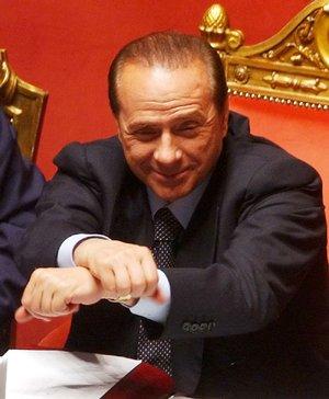 Italian Premier Silvio Berlusconi crosses his arms during a confidence vote at the Italian Senate, in Rome, Thursday, April 28, 2005.