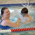 Gina Degnan of Bella Vista and her son Chase Degnan, 7, play in the leisure pool Sunday at the Bento...