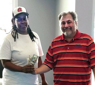 Submitted photo Gwendolyn Edwards, left, is one of three winners of the Lloyd's Lucky 333 sales event held June 1-3. Each winner received $300 by stopping in and filling out a credit application. With him is Charles Utt, a sales representative. Lloyd's Auto Sales is located at 1814 Albert Pike. For information, call 501-623-1717 or visit http://www.lloydsautosales.com.