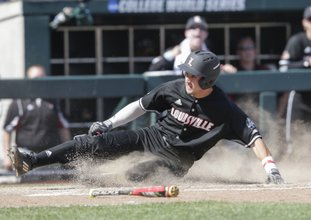 The Associated Press SLIDING IN AT HOME: Louisville's Ryan Summers scores at home on a single by Colby Fitch, who later advanced to second base on an error, in the eighth inning of a College World Series game against Texas A&M in Omaha, Neb., Sunday. Louisville won 8-4.