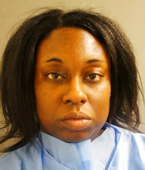 This photo provided by the Harris County Sheriff's Office in Houston shows Laquita Lewis, who has been charged with capital murder in the stabbing death of her 4-year-old daughter at a Houston apartment complex Sunday, June 18, 2017.