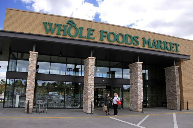 shoppers-stand-outside-a-whole-foods-market-in-upper-saint-claire-pa-in-may-amazons-planned-137-billion-purchase-of-the-grocery-store-chain-will-continue-to-emphasize-the-sale-of-locally-produced-foods