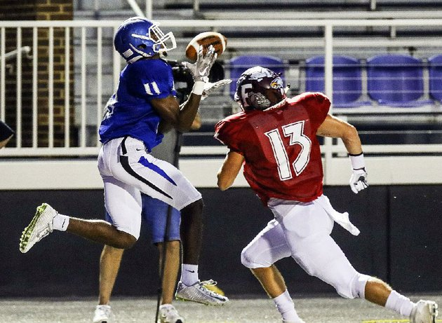 east-wide-receiver-marquis-pleasant-left-of-conway-hauls-in-a-pass-behind-west-defensive-back-tucker-hall-of-foreman-in-the-arkansas-high-school-coaches-association-all-star-football-game-friday-night-the-east-opened-up-a-35-point-lead-at-halftime-and-cruised-past-the-west-55-14