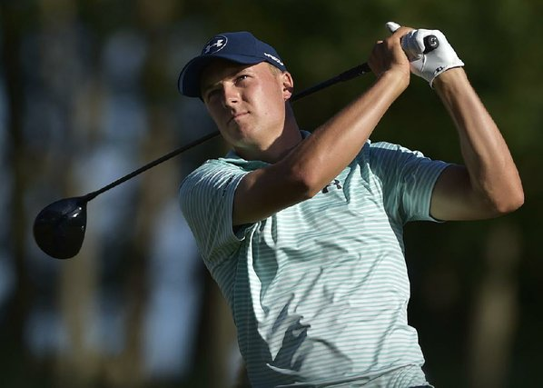 Bunker chip-in does it for Spieth