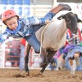 Dean Smallwood, 4, of Bentonville reaches for the ground Saturday while falling during the mutton bu...