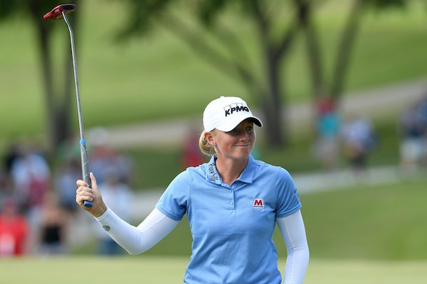 Stacy Lewis tips her putter to the crowd Saturday June 24, 2017 at the Northwest Arkansas Championship at Pinnacle Country Club in Rogers. Lewis finished 13 under par.