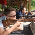 Parker Kyles (left) and Annie Downum, members of the Ozark Youth Shooting Team, shoot Saturday durin...