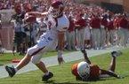 Arkansas quarterback Matt Jones scores a touchdown after breaking a tackle attempt by Texas defender Dakarai Pearson during a game Saturday, Sept. 13, 2003, in Austin, Texas.