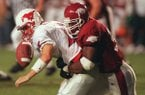 Arkansas defensive end Carlos Hall sacks SMU quarterback Josh McCown during a game Saturday, Sept. 19, 1998, in Little Rock.