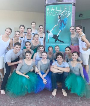 Photo submitted Ballet Magnificat! traveled to Guam, South Korea and China for a tour in March. In this picture they are in front of a banner in Guam and Siloam Springs native Taylor Stewart is on the middle row, second from the right.