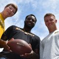 The Fayetteville High trio headed to play football at the University of Missouri are, from left, rec...
