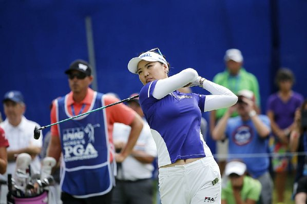 Choi grabs major lead at storm-halted Women's PGA