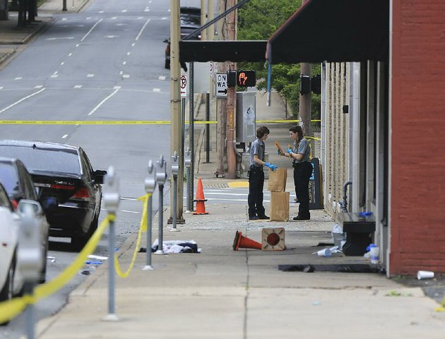 little-rock-police-department-crime-scene-personnel-collect-evidence-saturday-morning-after-the-shooting-at-power-ultra-lounge-at-220-w-sixth-st