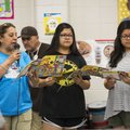 Lula Lopez, with Feed Your Brain programs, reads Monday as volunteers Venessa Almazan and sister Eri...