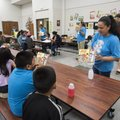 Nely Flores with Feed Your Brain programs talks to students Monday at George Elementary School about...