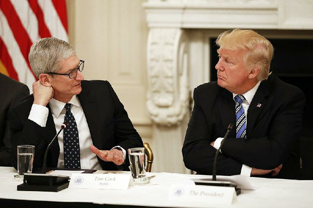 apple-ceo-tim-cook-speaks-with-president-donald-trump-at-an-american-technology-council-session-in-the-state-dinning-room-of-the-white-house-in-june