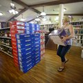 Stacey Latham, who along with her sister owns Two Sisterz Liquor store in Avoca, works Monday to sto...