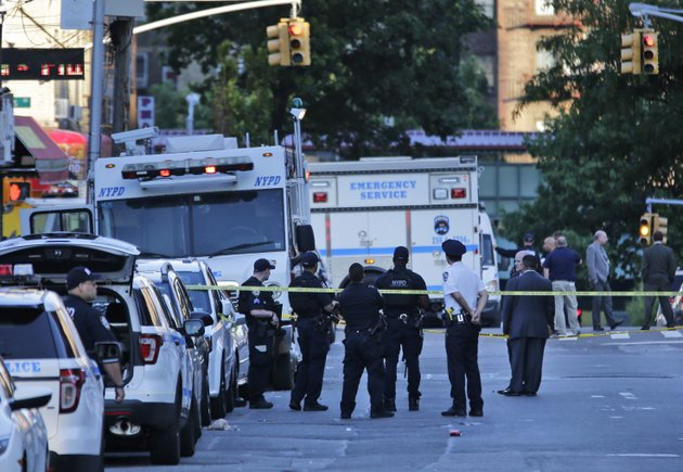 emergency-personnel-stand-near-the-scene-where-a-police-officer-was-fatally-shot-while-sitting-in-a-marked-vehicle-in-the-bronx-section-of-new-york-wednesday-july-5-2017-police-said-officer-miosotis-familia-died-at-a-hospital-early-wednesday-ap-photoseth-wenig