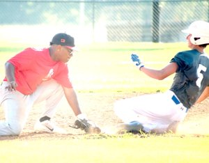 Photo by Rick Peck McDonald County shortstop Omar Manuel tags out a Seneca runner attempting to steal second base during McDonald County's 12-0 loss on June 28 at McDonald County High School.
