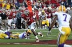 Arkansas receiver Cobi Hamilton runs after the catch before scoring an 80-yard touchdown on the final play of the first half during a game against LSU on Friday, Nov. 27, 2010, in Little Rock.