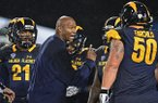 Kent State head coach Paul Haynes talks to the defense in the third quarter of an NCAA college football game against Western Michigan, Tuesday, Nov. 8, 2016, in Kent, Ohio. Western Michigan won 37-21. (AP Photo/David Dermer)