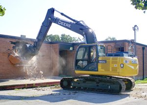 The start of demolition work at Gentry Intermediate School began shortly after 9 a.m. on Friday, July 7, 2017. Tom Smith of Red Line Construction in Lowell was operating the excavator.
