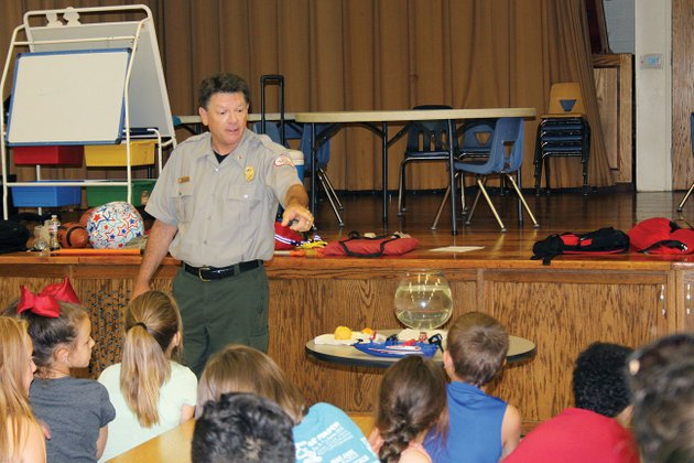 brian-westfall-a-natural-resource-specialist-with-the-us-army-corps-of-engineers-gives-a-water-safety-demonstration-at-hot-springs-lakeside-intermediate-school-on-june-30-westfall-stressed-the-importance-of-always-wearing-a-proper-lifejacket-when-in-or-around-water