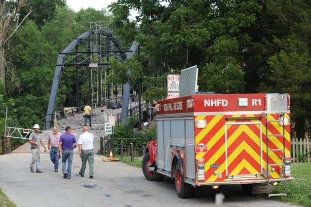 emergency-personnel-work-together-with-construction-crews-friday-at-the-war-eagle-bridge-as-they-search-for-a-person-believed-to-be-in-the-water-beneath-the-bridge