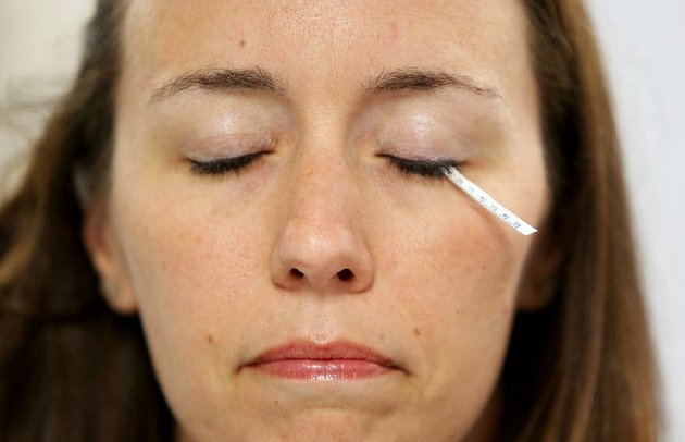 lindsay-rutherford-senior-scientist-at-ascendant-dx-uses-a-schirmers-strip-to-make-her-eye-water-and-test-herself-for-breast-cancer-wednesday-at-the-companys-lab-in-springdale