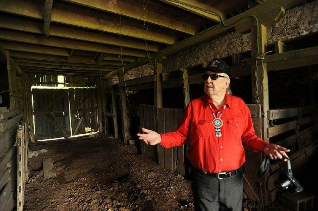 glenn-jones-a-former-benton-county-historic-preservation-commissioner-shows-off-the-inside-of-the-pre-civil-war-barn-at-fitzgerald-station-in-springdale