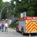 Emergency personnel work together Friday, July 7, 2017, with construction crews at the Historic War ...