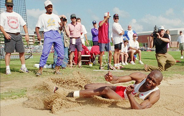Arkansas' Erick Walder competes in the long jump at the Southeastern Conference Outdoor Track and Field Championships, Saturday, May 14, 1994 in Fayetteville, Ark. Walder improved almost three feet in the finals and won his third straight outdoor title with a jump of 27-4 3/4. (AP Photo/Tom Ewart)