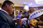 LSU football coach Ed Orgeron signs autographs during the Southeastern Conference's annual media gathering, Monday, July 10, 2017, in Hoover, Ala. (AP Photo/Butch Dill)