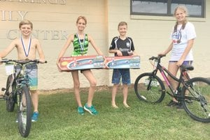 Photo submitted Pictured are the winners of the 11-and 12-year-old division of the Kids Triathlon held at the Family Aqautic Center. Pictured are winners: Girls, first place Isabelle Pastoor and second place Amy Blaha; boys, first place Jackson Bellomy and second place Grayson Manning.