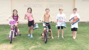 Photo submitted Pictured are the winners of the 7- to 8-year-old division of the Kids Triathlon held Saturday at the Family Aquatic Center. Winners were: Girls, first place Amelie Seauve and second place Zoe Blaha; boys, first place Deacon Maples, second place Tyler Keegan and third place Gideon Bergthold.