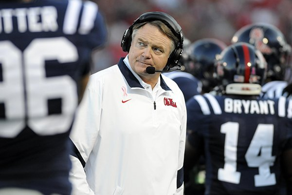 In this Saturday, Oct. 15, 2011, photo, Mississippi coach Houston Nutt casts a glance at the stadium video screen after a series of plays against No. 2 Alabama in an NCAA college football game in Oxford, Miss. (AP Photo/Austin McAfee)