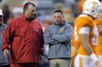 Arkansas head coach Bret Bielema, left, and Tennessee head coach Butch Jones talk before the start of an NCAA college football game Saturday, Oct. 3, 2015, in Knoxville, Tenn. Jones and Bielema, who both came into the SEC in 2013, are two of several coaches facing questions about their futures entering the 2017 season. (AP Photo/Wade Payne)