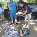 Yahir Pina (left) and his mom, Veronica Esquivel, select books Tuesday provided by Tillery Elementar...