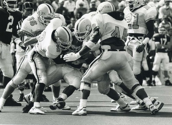 defenders for the citadel swarm arkansas running back ed jackson during the ncaa division i aa bulldogs 10 3 victory over the razorbacks at fayetteville