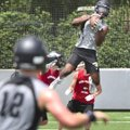 Kam'Ron Mays-Hunt of Bentonville High catches a pass Friday against Aurora Christian during the Sout...