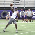 Fayetteville quarterback Darius Bowers throws a pass Friday during the Southwest Elite 7-on-7 tourna...