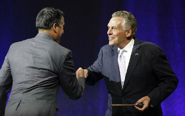govs-brian-sandoval-left-a-nevada-republican-and-terry-mcauliffe-a-virginia-democrat-attend-the-closing-session-saturday-of-the-national-governors-association-meeting-in-providence-ri-the-nations-health-care-system-was-front-and-center-at-this-summers-session