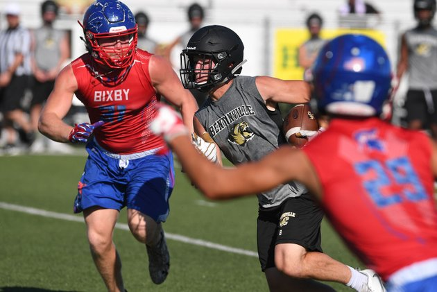 nwa-democrat-gazettejt-wampler-bentonvilles-easton-miller-looks-for-running-room-between-a-pair-of-bixby-defenders-saturday-during-the-annual-southwest-elite-7-on-7-tournament-at-shiloh-christian-saturday