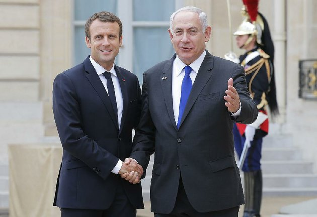 french-president-emmanuel-macron-left-and-israeli-prime-minister-benjamin-netanyahu-address-the-media-after-a-meeting-at-the-elysee-palace-in-paris-on-sunday