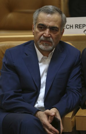 In this picture taken on Monday, July 3, 2017, Hossein Fereidoun, brother and top aide of moderate Iranian President Hassan Rouhani sits in a conference in Tehran, Iran. The semi-official Tasnim news agency reported on Sunday, July 16, that Hossein Fereidoun has been detained over financial matters.