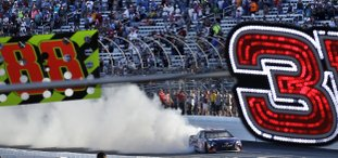 The Associated Press BURNING RUBBER: Driver Denny Hamlin smokes his tires as he passes fans after winning the NASCAR Cup Series 301 at the New Hampshire Motor Speedway in Loudon, N.H., Sunday.