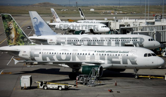 file-in-this-sept-22-2008-file-photo-frontier-airlines-planes-sit-stacked-up-outside-gates-on-the-a-concourse-in-denver-ap-photodavid-zalubowski-file