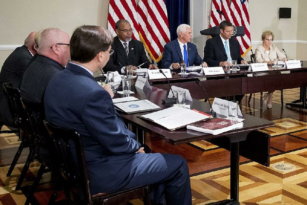 vice-president-mike-pence-center-gavels-in-the-first-meeting-of-the-presidential-advisory-commission-on-election-integrity-on-wednesday-in-washington-pence-said-the-panel-had-no-preordained-results-while-president-donald-trump-suggested-that-states-that-have-refused-to-comply-with-the-commissions-request-for-voter-information-have-something-to-hide