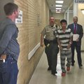 A sheriff's deputy escorts Mei Ka Sin on Thursday to a room in the Benton County Courthouse in Bento...